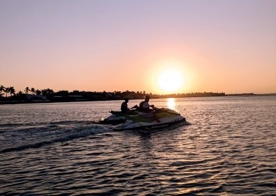 Sunset view of two jet skis in the ocean on Marco Island