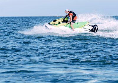 Man riding green jet ski off of Marco Island