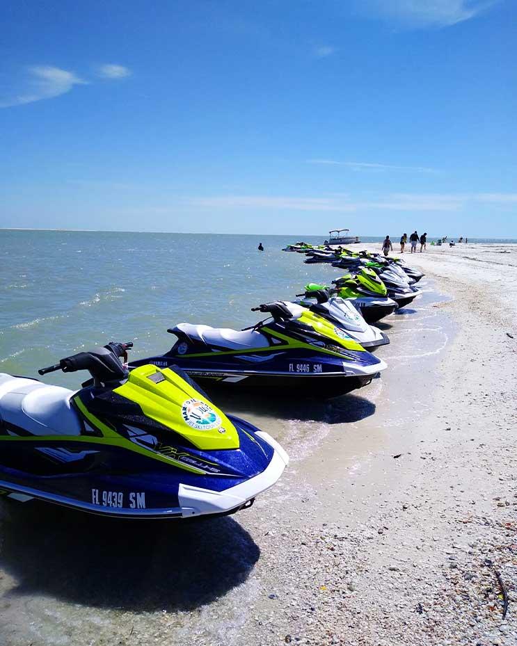 Jet ski rentals sitting on Marco Island beach