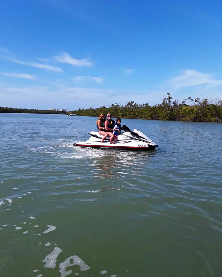 Family of 3 on a jet ski off of Marco Island